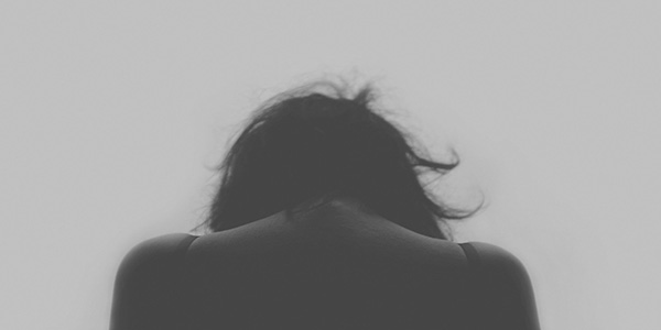 Picture of sad person from behind